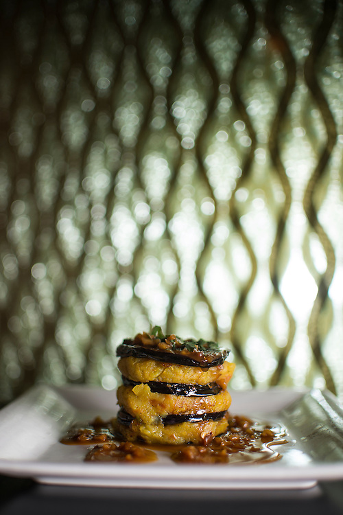 Photo by Matt Roth<br /> Assignment ID: 30142124A<br /> <br /> Tawa Baingan, made with eggplant, spiced potato, olive oil and peanut sauce. Rasika, one of Restauranteur Ashok Bajaj's most popular restaurants in Washington, D.C. on Thursday, May 09, 2013