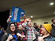 02 MARCH 2020 - ST. PAUL, MINNESOTA: NANCY KULEDGE, left, holds ATTICUS LANDSVERK, 2 ½ years old, on her shoulders, while her friend and Atticus' mother, LELA WRIGHT holds Atticus' twin brother, OLIVER LANDSVERK, at a Bernie Sanders Get Out the Vote rally in the RiverCentre in St. Paul. More than 8,400 people attended the rally. Minnesota is a Super Tuesday state this year and Minnesotans will go to the polls Tuesday. Minnesota Sen. Amy Klobuchar was expected to win her home state, but she dropped out early Monday, March 2.          PHOTO BY JACK KURTZ