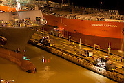 Cargo ships at dawn in Miraflores Locks. Panama Canal, Panama City, Panama, Central America.