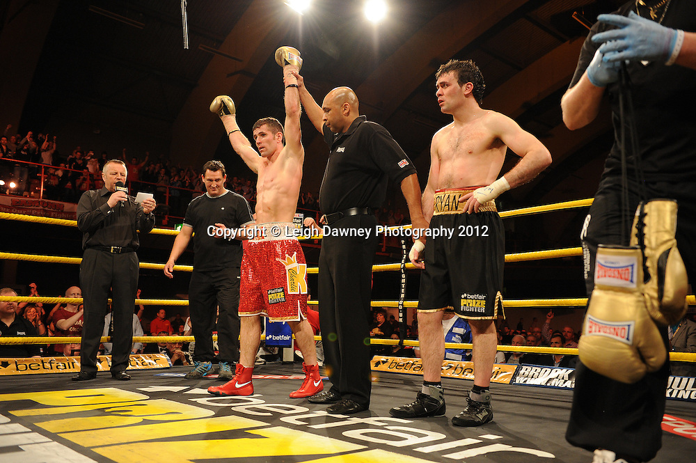 Eamonn O'Kane (red shorts) defeats Ryan Greene in Semi Final One at Prizefighter Middleweights, Kings Hall, Belfast, Northern Ireland on 5th May 2012. Promoted by Prizefighter/Matchroom Sport. © Leigh Dawney Photography 2012.