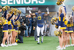 Nov 28, 2015; Morgantown, WV, USA; West Virginia Mountaineers wide receiver Kj Myers (19) is honored on senior day before their game against the Iowa State Cyclones at Milan Puskar Stadium. Mandatory Credit: Ben Queen-USA TODAY Sports