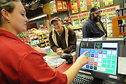Clerk Cherish Loetscher rings up a purchase for rookie driver Eric Resner at the TA Travel Store in Morris, Illinois.
