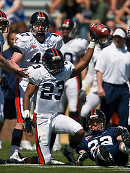 Virginia cornerback Dom Joseph (23) reacts after intercepting a pass intended for Virginia wide receiver Staton Jobe (22).  The Virginia Cavaliers football team played the annual spring football scrimmage at Scott Stadium on the Grounds of the University of Virginia in Charlottesville, VA on April 18, 2009.  (Special to the Daily Progress / Jason O. Watson)