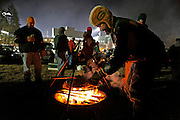Fans cook brats on an open fire before an NFL football game against the Baltimore Ravens Monday, Dec. 7, 2009, in Green Bay, Wis. (AP Photo/Jeffrey Phelps)