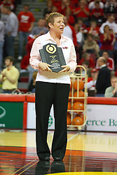 "31 January 2009: Missouri Valley Commissioner Doug Elgin presented Molly Arnold with the conferences Most Courageous Award.  Molly battle cancer. The Illinois State University Redbirds join the Bradley Braves in a tie for 2nd place in ""The Valley"" with a 69-65 win on Doug Collins Court inside Redbird Arena on the campus of Illinois State University in Normal Illinois"