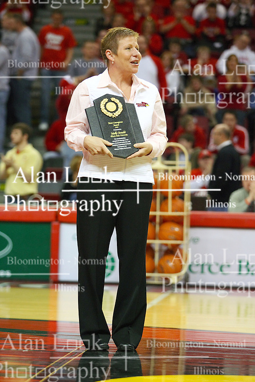 """31 January 2009: Missouri Valley Commissioner Doug Elgin presented Molly Arnold with the conferences Most Courageous Award.  Molly battle cancer. The Illinois State University Redbirds join the Bradley Braves in a tie for 2nd place in """"The Valley"""" with a 69-65 win on Doug Collins Court inside Redbird Arena on the campus of Illinois State University in Normal Illinois"""