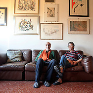 Rome, Olympic Village..Beppi and Graziella live in Portogallo street of the Olympic village since it was transformed to a residential area. Their flat was assigned to Graziella's father in 1960 as he worked for Agriculture Bank. Graziella is an overage teacher and her husband is a retired governmental employee. Two years ago they decided to sell their apartment and buy a smaller flat in a building with elevator. Many old residents of the village lament the same problem. ..In the middle of Parioli and Flaminio smart districts in Rome, along the ancient Via Flaminia one of the first Olympic villages was built for the 17th Olympic Games. After the end of the games a new residential district was created after assigning the flats to beneficiaries. The last five years the village's population is changing. The construction of the Auditorium next to the village increased  the request for apartments mostly from Rome's upper class, architects, engineers, teacher, lecturers are buying more and more  apartments in order to renovate them  and live there with their families  due to the oversize facilities, parking space  and green areas for their children to play. Twenty years ago a flat at the Olympic village that cost approximately 18,000 euros now its price has rise to 400-500,000 euros.