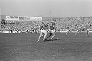 Kilkenny tries to get around Cork to retrieve the ball during the All Ireland Senior Hurling Final, Cork v Kilkenny in Croke Park on the 3rd September 1972. Kilkenny 3-24, Cork 5-11.