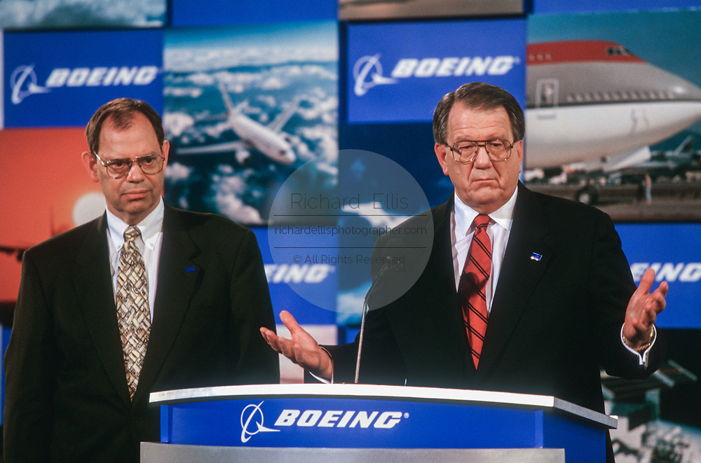 WASHINGTON, DC, USA - 1997/08/04: McDonald Douglas CEO Harry Stonecipher, right, and Boeing CEO Philip Condit, during the announcement of details on their merger at the Smithsonian's National Air & Space Museum August 4, 1997 in Washington, DC.  (Photo by Richard Ellis)