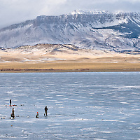 Fishing on frozen lake, ice fishing montana, USA