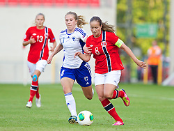 LLANELLI, WALES - Thursday, August 22, 2013: Norway's Guro Reiten in action against Finland's Erika Winter during the Group B match of the UEFA Women's Under-19 Championship Wales 2013 tournament at Parc y Scarlets. (Pic by David Rawcliffe/Propaganda)