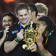 Ma'a Nonu, New Zealand, kisses the Web Ellis trophy held by RichieMcCaw after the trophy presentation during the New Zealand V France Final at the IRB Rugby World Cup tournament, Eden Park, Auckland, New Zealand. 23rd October 2011. Photo Tim Clayton...