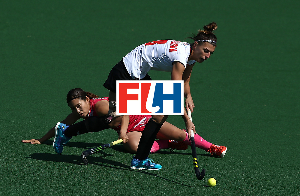 JOHANNESBURG, SOUTH AFRICA - JULY 14:  Natalia Wisniewska of Poland and Yuri Nagai of Japan battle for possession during day 4 of the FIH Hockey World League Semi Finals Pool B match between Poland and Japan at Wits University on July 14, 2017 in Johannesburg, South Africa.  (Photo by Jan Kruger/Getty Images for FIH)