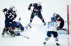 Janne Pesonen of Finland and Jussi Jokinen of Finland vs Torey Krug of USA and Connor Hellebuyck of USA during Ice Hockey match between USA and Finland at Day 1 in Group B of 2015 IIHF World Championship, on May 1, 2015 in CEZ Arena, Ostrava, Czech Republic. Photo by Vid Ponikvar / Sportida