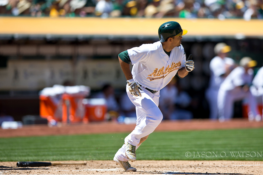 OAKLAND, CA - MAY 26:  Coco Crisp #4 of the Oakland Athletics hits a sacrifice fly for an RBI against the Detroit Tigers during the fourth inning at O.co Coliseum on May 26, 2014 in Oakland, California. The Oakland Athletics defeated the Detroit Tigers 10-0.  (Photo by Jason O. Watson/Getty Images) *** Local Caption *** Coco Crisp
