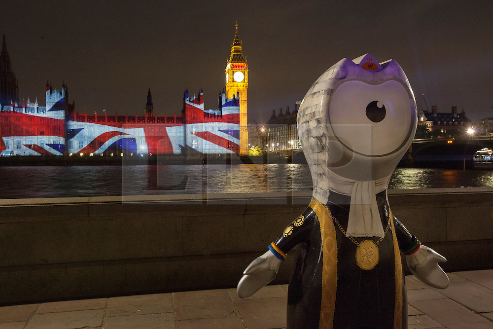 © licensed to London News Pictures. London, UK 27/07/2012. A Wenlock sculpture pictured whilst union flag being projected on the Houses of the Parliaments during the Olympics opening ceremony on 27/07/12. Photo credit: Tolga Akmen/LNP