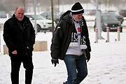 MK Dons fans arriving at the stadium in the snow before the EFL Sky Bet League 1 match between Milton Keynes Dons and Bristol Rovers at stadium:mk, Milton Keynes, England on 3 March 2018. Picture by Nigel Cole.