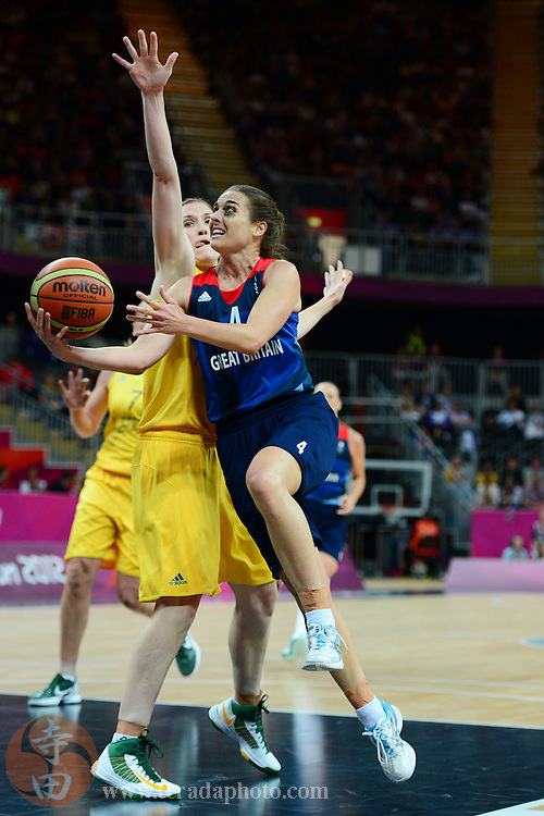 Jul 28, 2012; London, United Kingdom; Great Britain guard Natalie Stafford (4) drives to the basket against Australia during the first half at Basketball Arena.