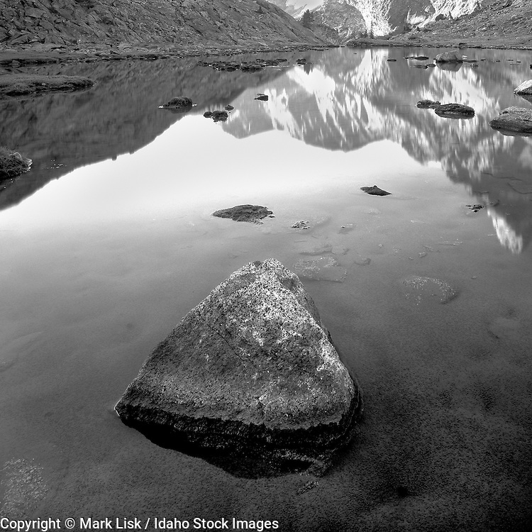 A triangular shaped rock sits undisturbed in the upper Wild Horse Lake high in Idaho's Pioneer Mountains.