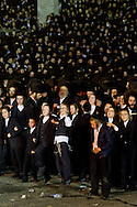 An estimated 70,000 members of an ultra-Orthodox Jewish community attend a bonfire celebration marking the Jewish holiday of Lag Baomer, Saturday, May 17, 2014 in Kiryas Joel, N.Y. Local organizers say it is the largest such celebration in the United States. (