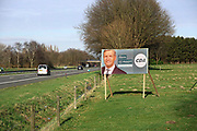 Nederland, Wijchen, 10-3-2017Verkiezingsbord in een weiland van het CDA voor de komende verkiezingen voor de tweede kamer. Netherlands, election board with posters for the forthcoming local elections.  Sybrand Buma .Foto: Flip Franssen