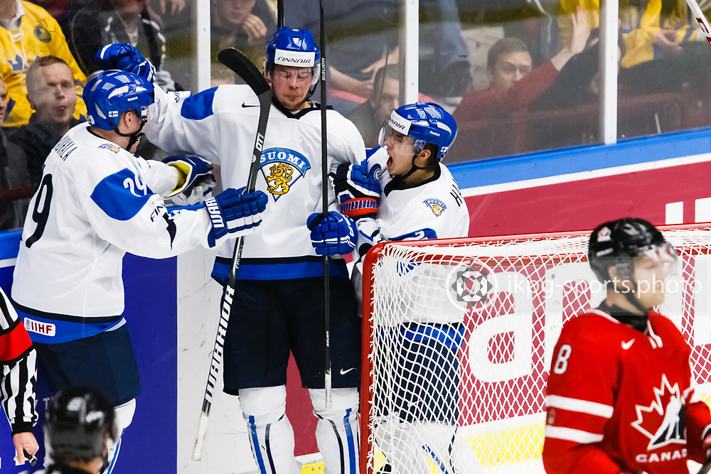140104 Ishockey, JVM, Semifinal,  Kanada - Finland<br /> Icehockey, Junior World Cup, SF, Canada - Finland.<br /> Team Finland celebrates goal 0-1 by Joni Nikko.<br /> Otto Rauhala, Mikko Vainonen.<br /> m&aring;l, jubel, jublar, deppar, depp, k&auml;nslor.<br /> Endast f&ouml;r redaktionellt bruk.<br /> Editorial use only.<br /> &copy; Daniel Malmberg/Jkpg sports photo