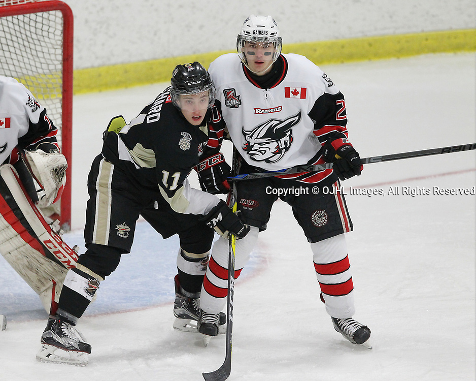 GEORGETOWN, ON  - APR 18,  2017: Ontario Junior Hockey League, Championship Series. Georgetown Raiders vs the Trenton Golden Hawks in Game 3 of the Buckland Cup Final. Jordan Chard #11 of the Trenton Golden Hawks and Austin Cho #20 of the Georgetown Raiders battle for position in the crease during the first period.<br /> (Photo by Tim Bates / OJHL Images)