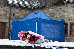 © Licensed to London News Pictures . 17/01/2016 . Rossendale , UK . Flowers left at the scene on Sunny Bank Road , Helmshore , where 60-year-old Sadie Hartley was discovered with multiple stab wounds at her home at 22:40 GMT on Friday (15th January 2016) . Photo credit : Joel Goodman/LNP