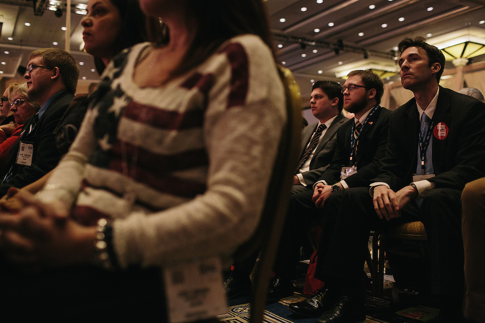 Brent Eastwood, right, and others listen to Sen. Rand Paul speak during day two of the Conservative Political Action Conference (CPAC) at the Gaylord National Resort & Convention Center in National Harbor, Md.