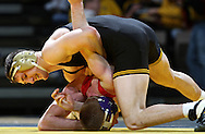 Iowa's Derek St. John works against Southern Illinois Edwardsville's Kyle Lowman during the 157-pound bout of their dual at Carver-Hawkeye Arena, 1 Elliot Drive in Iowa City on Friday evening January 7, 2010. St. John defeated Lowman 9-2 and Iowa defeated Southern Illinois Edwardsville 49-0.