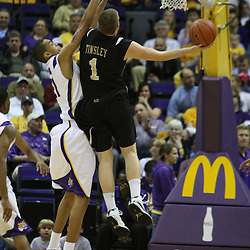 4 March 2009: Brad Tinsley (1) of Vanderbilt shoots over LSU center Chris Johnson (21) during a NCAA basketball game between SEC rivals the Vanderbilt Commodores and the LSU Tigers at the Pete Maravich Assembly Center in Baton Rouge, LA.