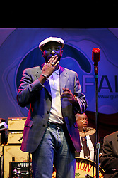 16 May 2010. New Orleans, Louisiana. <br /> Gulf Aid - a benefit festival for Louisiana fishermen and our coast.<br /> Mos Def performs with the Preservation Hall Jazz band on the Wetlands indoor stage. <br /> Local musicians have gathered together in response to BP's massive oil spill in the Gulf of Mexico, threatening the very fabric of an entire region. All proceeds from the event will be used to support local fishing communities and the region.<br /> Photo credit; Charlie Varley/varleypix.com
