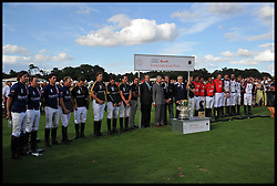 HRH The Prince of Wales with the USA team (left) and The English Team (right)  after England beat The USA in the  Audi International Polo 2013-Westchester Cup Polo match Audi England v Equus & Co USA at the <br /> Guards Polo Club, Egham, United Kingdom,<br /> Sunday, 28th July 2013<br /> Picture by Andrew Parsons / i-Images