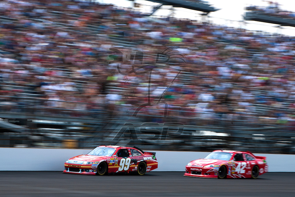Speedway, IN  - JUL 31, 2011:  Carl Edwards (99) races to turn one for the Brickyard 400 presented by BigMachineRecords.com at Indianapolis Motor Speedway in Speedway, IN.