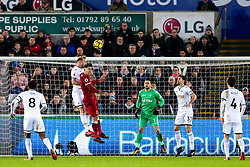 Mike van der Hoorn of Swansea City challenges Roberto Firmino of Liverpool - Rogan/JMP - 22/01/2018 - FOOTBALL - Liberty Stadium - Swansea, Wales - Swansea City v Liverpool - Premier League.