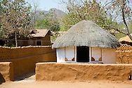 A traditonal thatched round house in the Shilpgram Craftsmen's Village;  Udaipur, Rajasthan, India