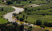 The Animas River meanders through the river valley north of Durango, Colorado discolored by toxic wastewater following the Gold King Mine spill August 5. This region is used for agriculture.