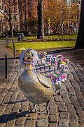 Duckling sculpture based on make way for ducklings with their Easter bonnet on