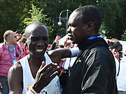 Eliud Kipchoge (KEN), left, celebrates with coach Patrick Sang after winning the 45th Berlin Marathon in a world best 2:01.39 in Berlin, Germany, Sunday, Sept. 16, 2018.. Kipchoge  broke the previous record by 1:18 set in 2014  by Dennis Kimetto. It is the largest single improvement on the marathon world record since Derek Clayton improved the mark by 2:23 in 1967. (Jiro Mochizuki/Image of Sport)