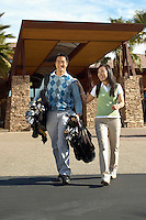 Man Carrying his Girlfriend's Golf Clubs