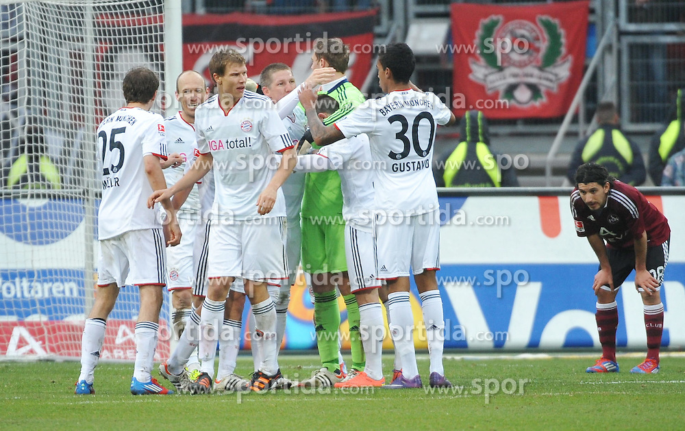 31.03.2012, Easy-Credit-Stadion, Nuernberg, GER, 1. FBL, 1. FC Nuernberg vs FC Bayern Muenchen, 28. Spieltag, im Bild Die Spieler des FC Bayern Muenchen bejubeln nach Abpfiff den Sieg gegen den 1. FC Nuernberg. Frust bei den Nuernbergern. Hinten rechts: Almog Cohen (1.FC Nuernberg). // during the German Bundesliga Match, 28th Round between 1. FC Nuernberg and FC Bayern Munich at the Easy-Credit-Stadium, Nuernberg, Germany on 2012/03/31. EXPA Pictures © 2012, PhotoCredit: EXPA/ Eibner/ Matthias Merz..***** ATTENTION - OUT OF GER *****
