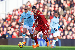 LIVERPOOL, ENGLAND - Saturday, February 24, 2018: Liverpool's Emre Can and West Ham United's Joao Mario during the FA Premier League match between Liverpool FC and West Ham United FC at Anfield. (Pic by David Rawcliffe/Propaganda)