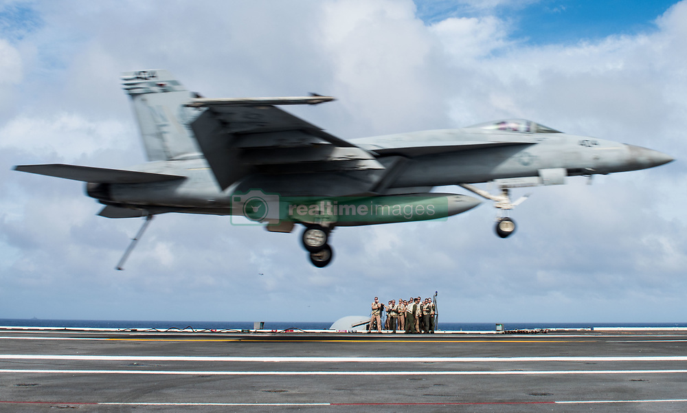 WATERS SOUTH OF JAPAN (Aug. 15, 2018) Landing signal officers observe as an F/A-18E Super Hornet assigned to Strike Fighter Squadron (VFA) 195 lands on the flight deck of the Navy's forward-deployed aircraft carrier, USS Ronald Reagan (CVN 76). Ronald Reagan, the flagship of Carrier Strike Group 5, provides a combat-ready force that protects and defends the collective maritime interests of its allies and partners in the Indo-Pacific region. (U.S. Navy photo by Mass Communication Specialist 2nd Class Kenneth Abbate/Released)180815-N-OY799-0132