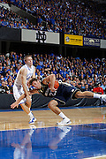 Jon Hood (4) of the Kentucky Wildcats pulls down Tim Abromaitis (21) of the Notre Dame Fighting Irish in the DirecTV SEC-Big East Invitational at Freedom Hall in Louisville, Kentucky on Dec. 8, 2010. (Photo by Joe Robbins)