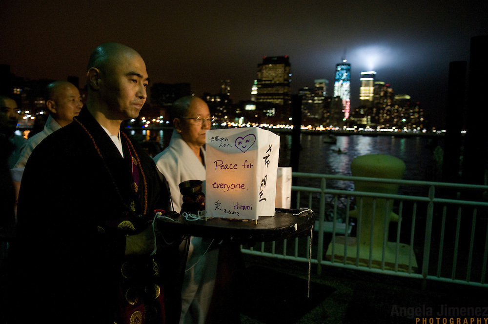 People attend the 9-11 World Trade Center Memorial Floating Lanterns Ceremony on the tenth anniversary of the 9-11 terrorist attacks on Pier 40 in New York City on September 11, 2011. <br />