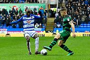 Sone Aluko (14) of Reading challenges Jack Bidwell (3) of Queens Park Rangers during the EFL Sky Bet Championship match between Reading and Queens Park Rangers at the Madejski Stadium, Reading, England on 30 March 2018. Picture by Graham Hunt.