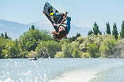 Male athlete flipping while wake boarding on the Snake River in Burley, Idaho.