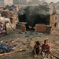 Kids are playing near the hazardous lather industry. Lots of worker live in this polluted industrial area with their families. Hazaribag, Dhaka.
