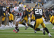 November 20 2010: Ohio State Buckeyes tight end Jake Stoneburner (11) has his face mask pulled by Iowa Hawkeyes linebacker Jeremiha Hunter (42) during the third quarter of the NCAA football game between the Ohio State Buckeyes and the Iowa Hawkeyes at Kinnick Stadium in Iowa City, Iowa on Saturday November 20, 2010. Hunter was called for the foul. Ohio State defeated Iowa 20-17.