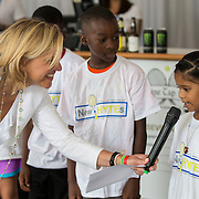 August 15, 2014, New Haven, CT:<br /> Tournament director Anne Worcester introduces kids from the New HYTEs youth development organization during the draw ceremony at the 2014 Connecticut Open at the Yale University Tennis Center in New Haven, Connecticut Friday, August 15, 2014.<br /> (Photo by Billie Weiss/Connecticut Open)